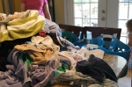 dump it all on the counter, line up all the baskets, and become the human clothes sortingMACHINE!