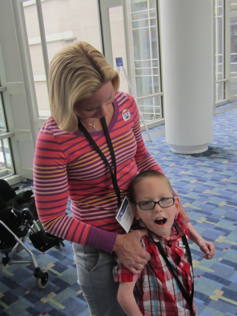 Taking a break from the wheelchair with his mom